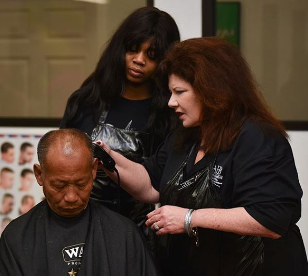 instructor helping student with haircut