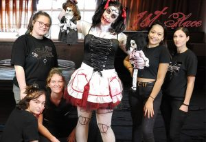 group of students with one wearing scary doll makeup