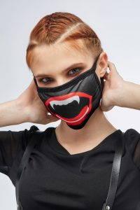 woman wearing mask with fangs