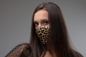 woman wearing a cheetah print face mask