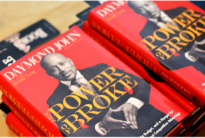 photo of a book cover. Book is called Power of Broke by Daymond John
